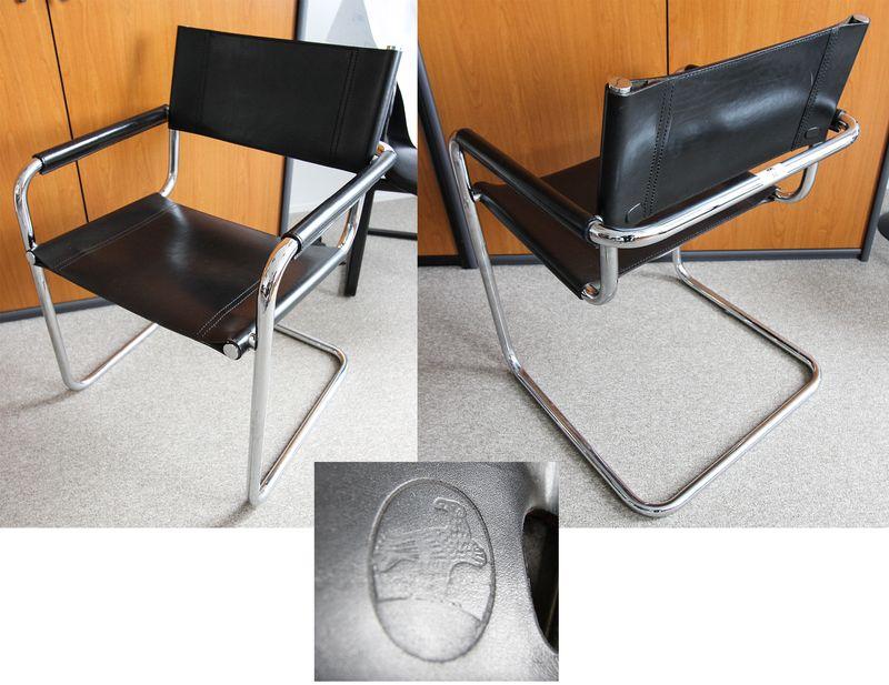 paire de fauteuils a structure en metal chrome tubulaire garni de